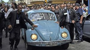 Mujica's VW Beetle and security detail